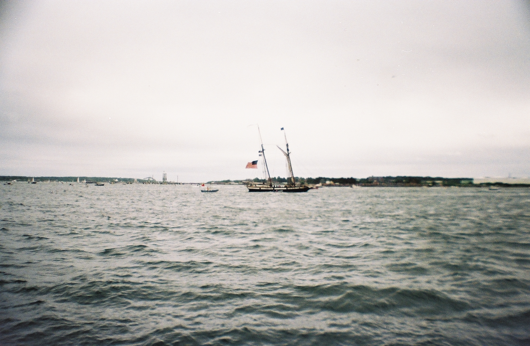 A flag can be seen from one of the tall ships